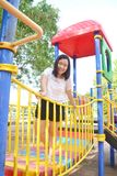 Girl playing at playground. Playground at the park for children Stock Photography