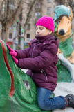 Girl playing in the playground with sculptures. Made by Krylovs fables. Ivan Krylov was born February 13, 1769 and died November 21, 1844 royalty free stock photos