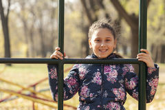 The girl playing on the playground Royalty Free Stock Photos