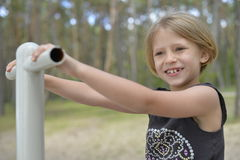 A girl is playing on the playground. Stock Photos