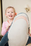 Girl Playing with Plush Toy Royalty Free Stock Photo
