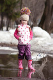 Girl playing in puddles Stock Photography
