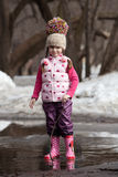 Girl playing in puddles Royalty Free Stock Photography