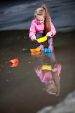 Girl playing in puddles Royalty Free Stock Photos