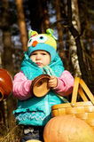 Girl playing with pumpkins on autumn nature Stock Image