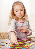 Girl playing puzzle Stock Photo