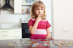 Girl, playing puzzles Stock Image