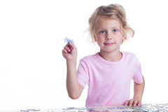 Girl playing puzzles Royalty Free Stock Image
