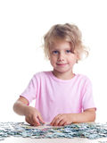 Girl playing puzzles Royalty Free Stock Photography