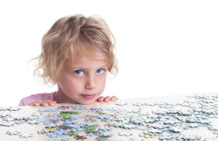Girl playing puzzles Royalty Free Stock Photos