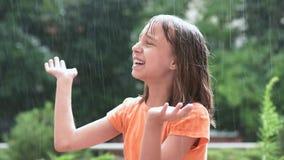 Girl playing in rain stock video