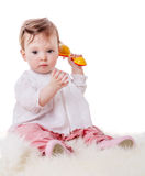 Girl playing rattle royalty free stock photography