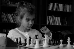 Girl playing real chess Royalty Free Stock Photos