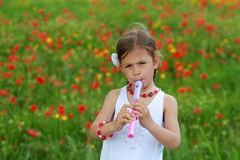 Girl playing the recorder Royalty Free Stock Images