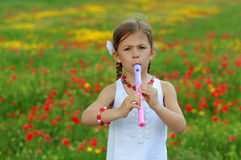Girl playing the recorder Royalty Free Stock Photo