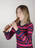 girl playing recorder Royalty Free Stock Photos