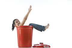 Girl playing with red bin Stock Photos