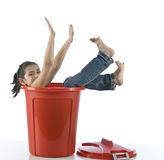 Girl playing with red bin royalty free stock photography