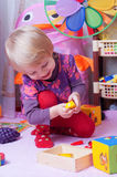 Girl in playing room with toys Stock Photo