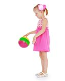 Girl playing in the rubber ball Royalty Free Stock Photo