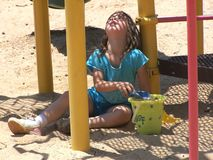 Girl playing in the sand Stock Photos