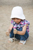 Girl playing with sand Royalty Free Stock Photography