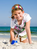 Girl playing in the sand Stock Image