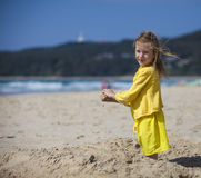 Girl PLaying in Sand at the Beach Royalty Free Stock Images