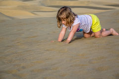 Girl playing on the sand dunes Royalty Free Stock Photography