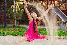 Girl playing with sand Stock Photography