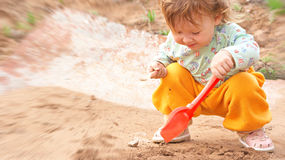 Girl playing in the sandbox Stock Photo