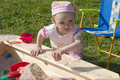 Girl playing in sandbox Royalty Free Stock Photography