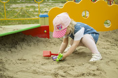 Girl playing in the sandbox. Close-up Royalty Free Stock Image