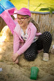 Girl playing in sandbox Stock Image