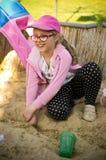 Girl playing in sandbox Stock Image