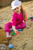 Girl playing in sandbox Royalty Free Stock Photo