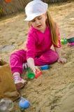 Girl playing in sandbox Royalty Free Stock Photo