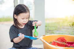 Girl playing with sandbox Royalty Free Stock Photos