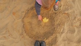 The Girl Is Playing In The Sandbox. The Sandbox, A Little Blonde Sculpts Figurines From Sand. The Girl Is Playing In The Sandbox. The Sandbox, A Little Blonde stock video footage