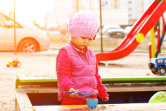 Girl playing in the sandbox. Royalty Free Stock Photo