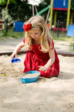 Girl playing in sandpit Stock Image