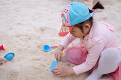 Girl are playing sands. Royalty Free Stock Images