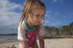 Girl playing on sandy beach Royalty Free Stock Photo