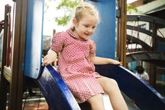 Girl playing at school playground royalty free stock image