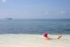 Girl playing in sea royalty free stock image