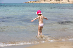 Girl playing on sea beach Stock Image