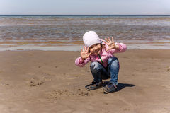 Girl is playing on the sea shore Royalty Free Stock Photo