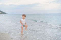 Girl Playing in Sea Stock Images