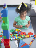 Girl Playing With Shape Puzzles In Class Royalty Free Stock Photography