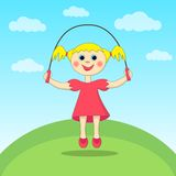 Girl playing with a skipping-rope Royalty Free Stock Photo